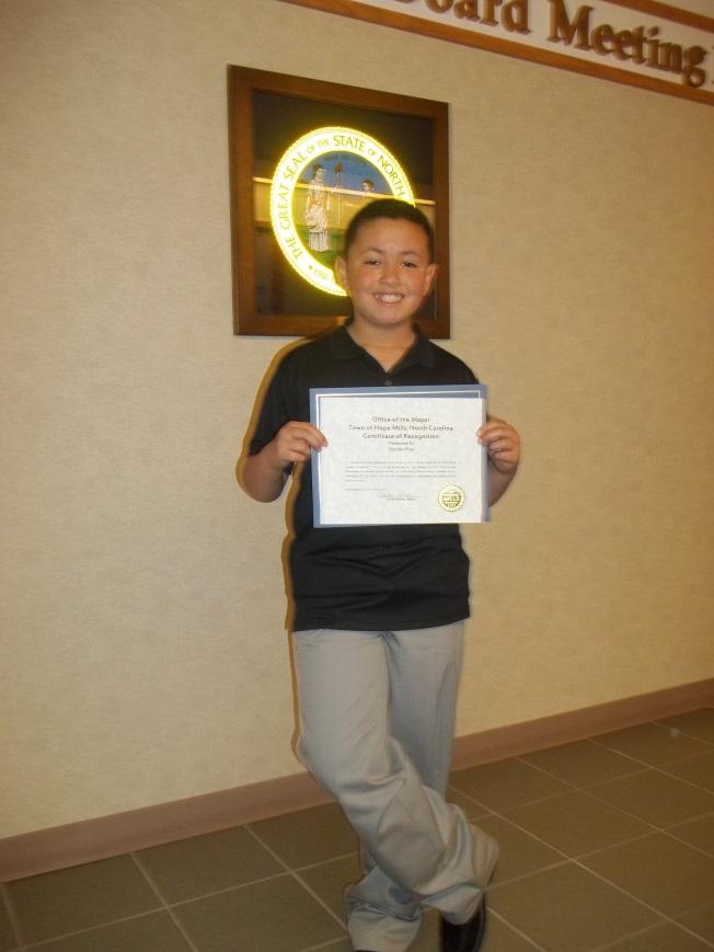 Alizdair Proudly Displays His Certificate