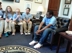 Coy Parrott speaking at Congressman McIntyre's office