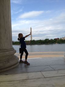 Alea holding up the Washington Monument