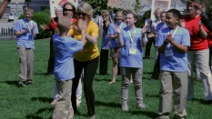 Garner, NC 4th grader Lincoln Sawyer giving a high-five to NC State Librarian Cal Shepard