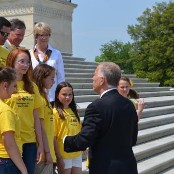 Senator Tillis talks to NCLA's Library Ambassadors on the steps of the US Capitol