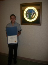 Alizdair with his Certificate of Recognition