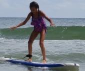 Naomi surfing